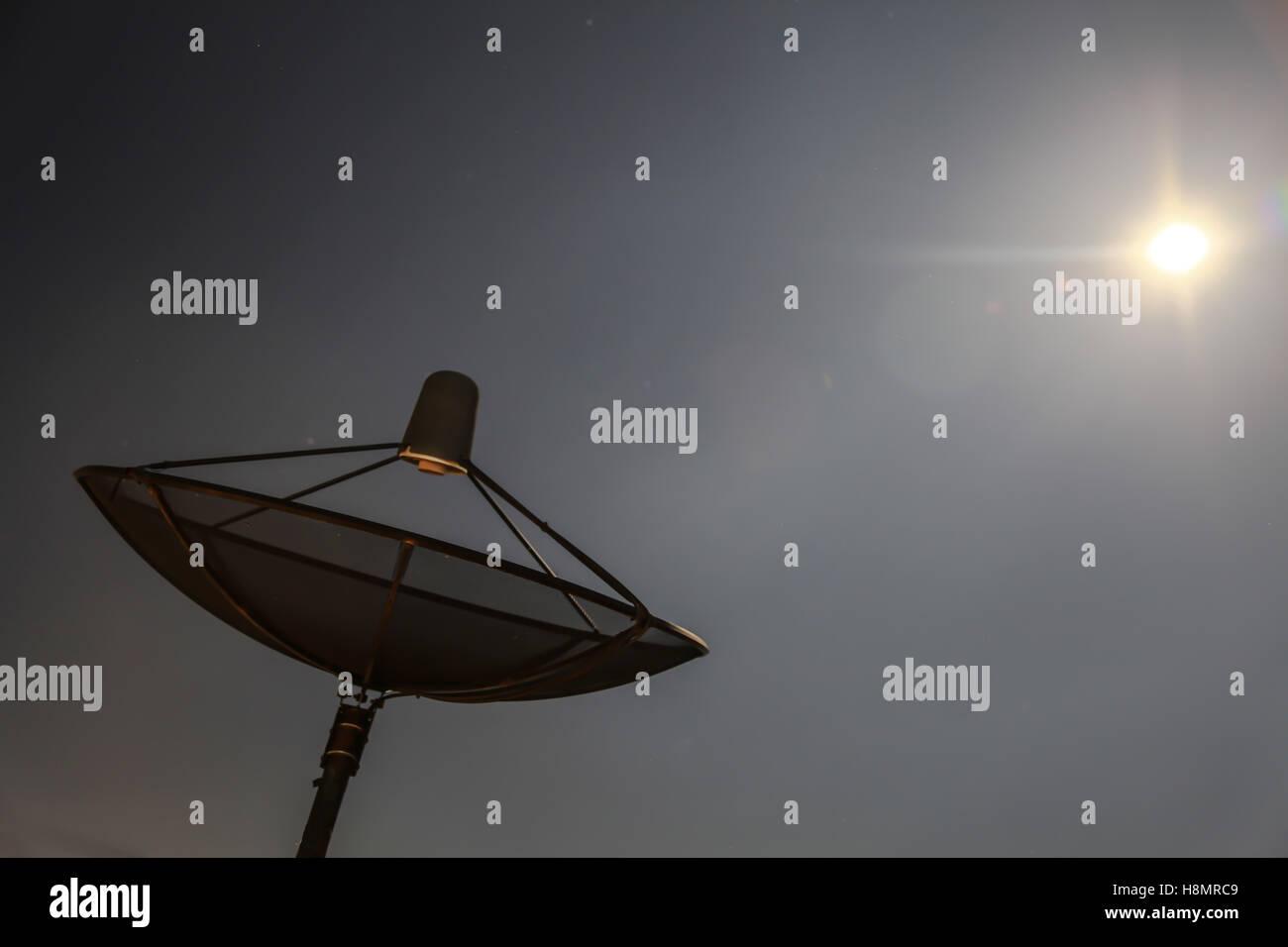 Satellite tv in full moon night - Stock Image
