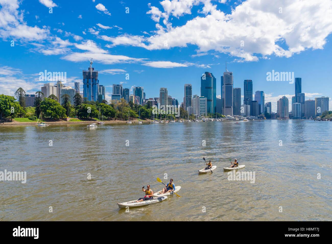 Tourists kayaking along the Brisbane River, Australia - Stock Image