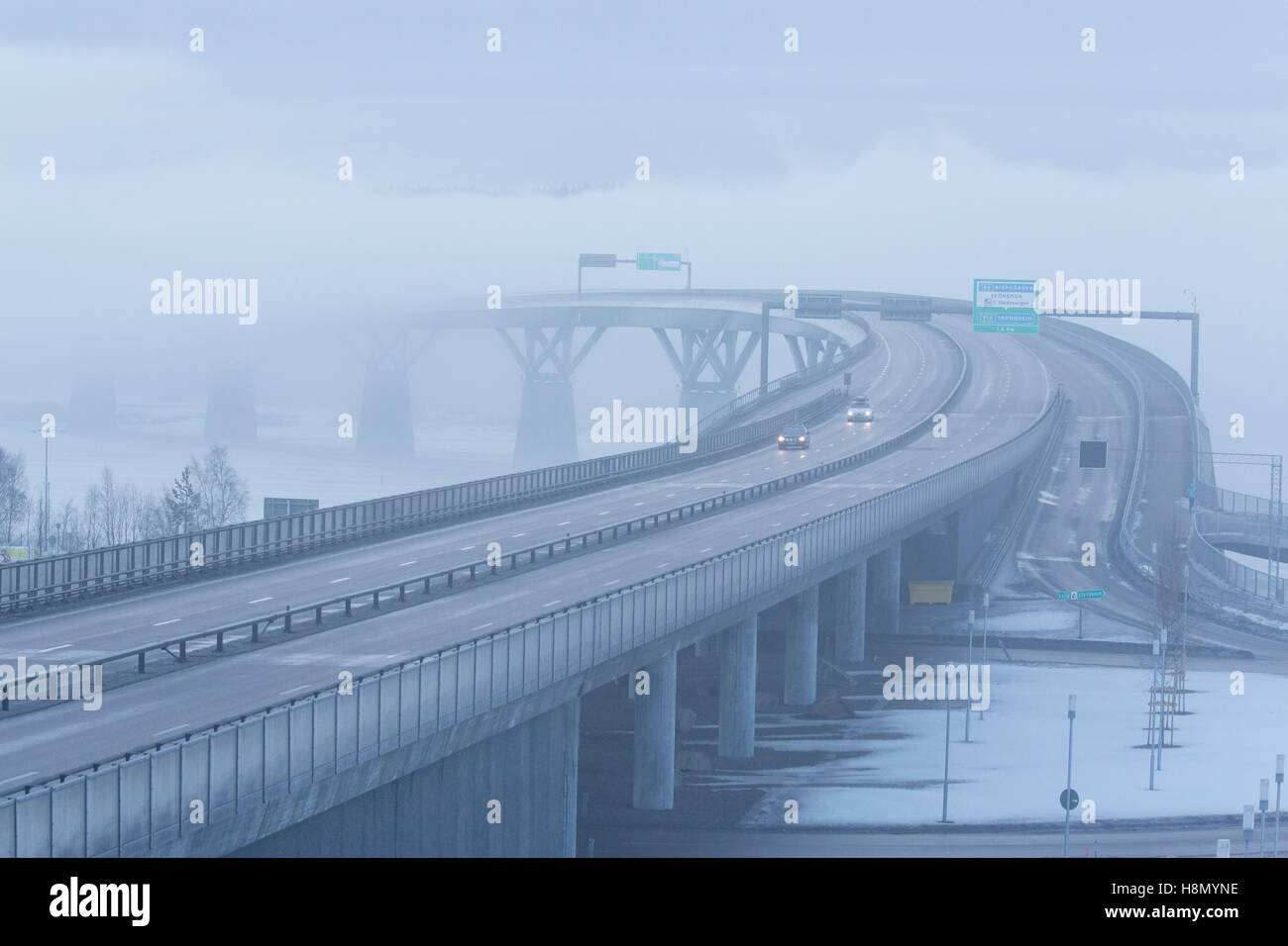 Elevated highway in fog - Stock Image