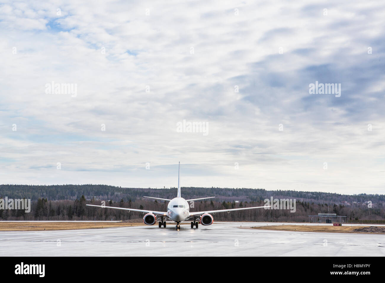 Airplane on runway - Stock Image