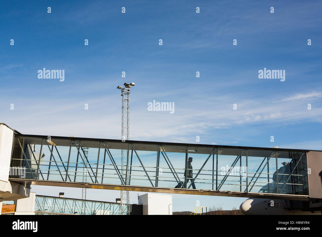 Elevated walkway at airport - Stock Image