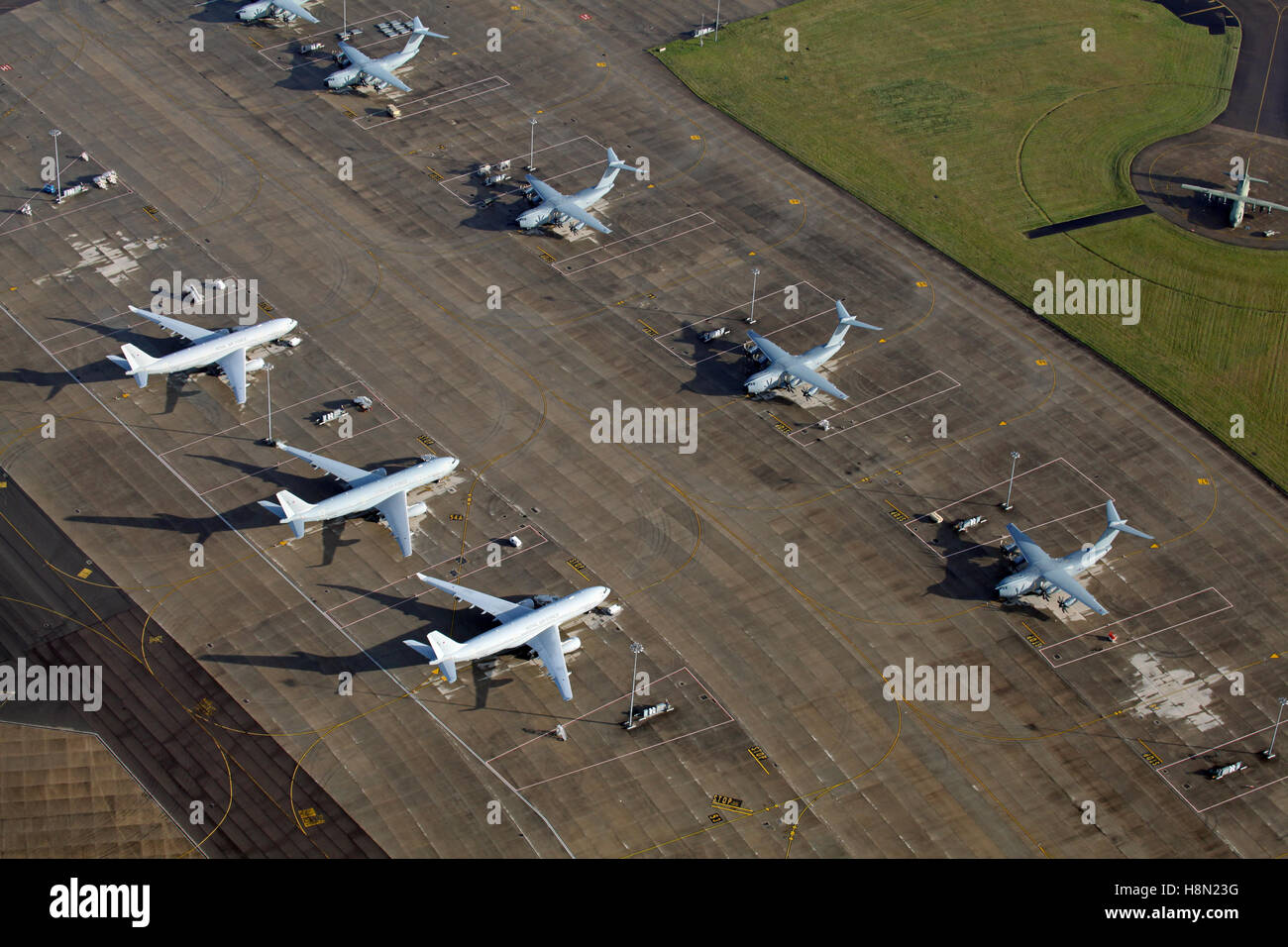 aerial view of RAF Brize Norton with 3 Airbus A330 Voyager & 5 A400M Atlas aircraft parked, Oxfordshire, UK - Stock Image