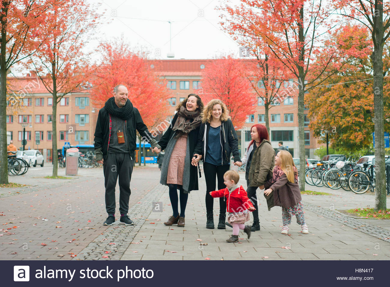 Family with four daughters (2-3, 4-5, 10-11, 16-17) in street Stock Photo