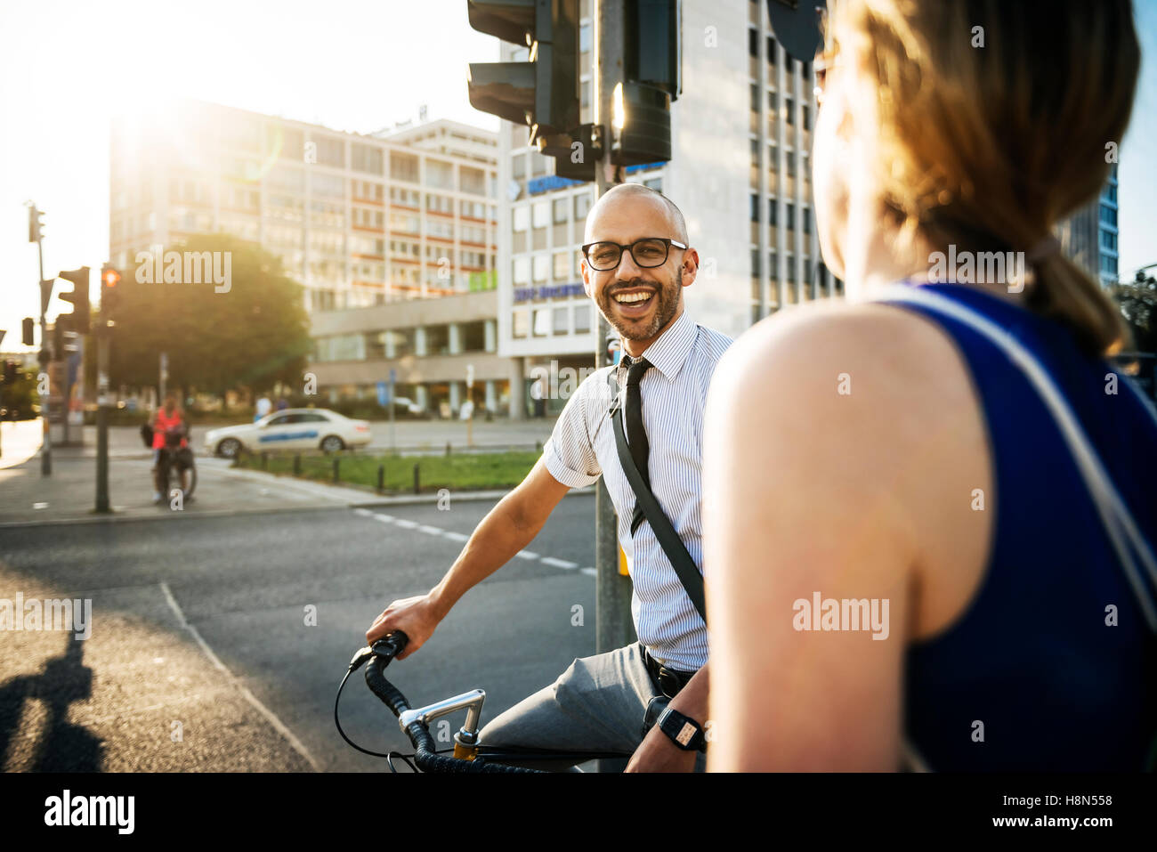 Man and woman in city, man smiling - Stock Image