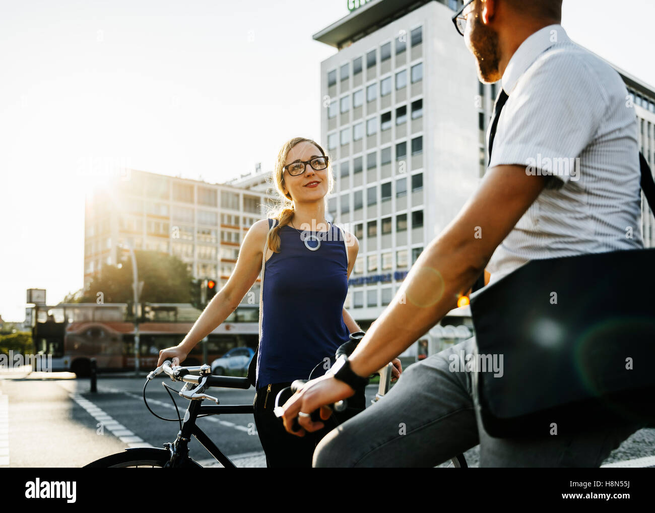Man and woman in city, woman smiling - Stock Image