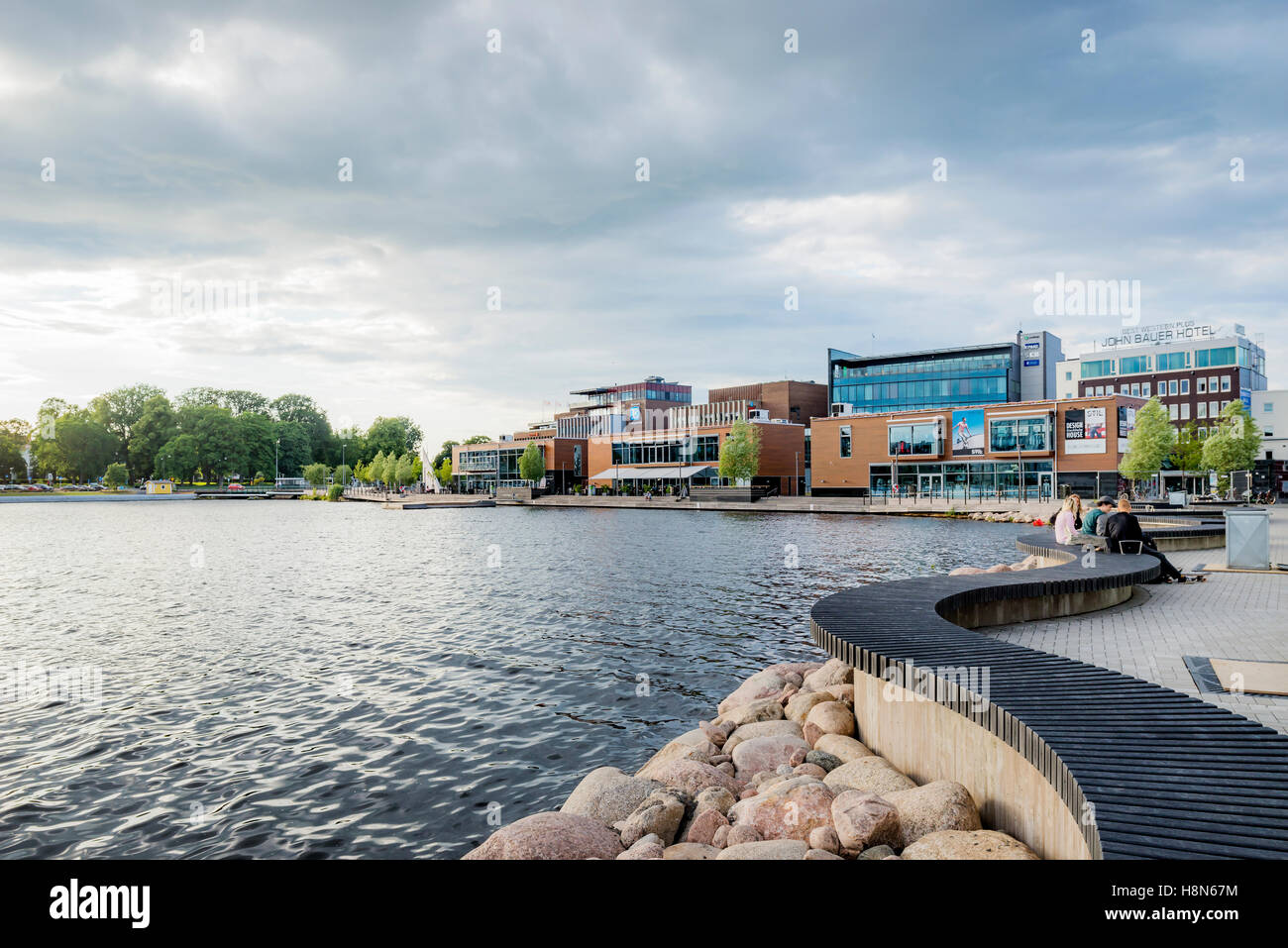 Sweden, Smaland, Jonkoping, Overcast sky above waterfront district - Stock Image