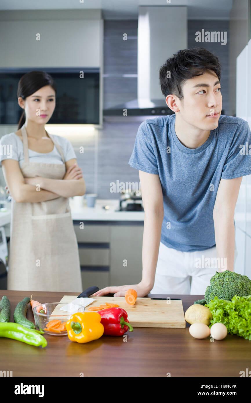 Couple Cooking Kitchen Serious Stock Photos & Couple Cooking Kitchen ...