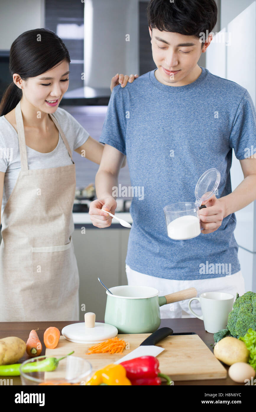 Young Indian Couple Cooking In Stock Photos & Young Indian Couple ...