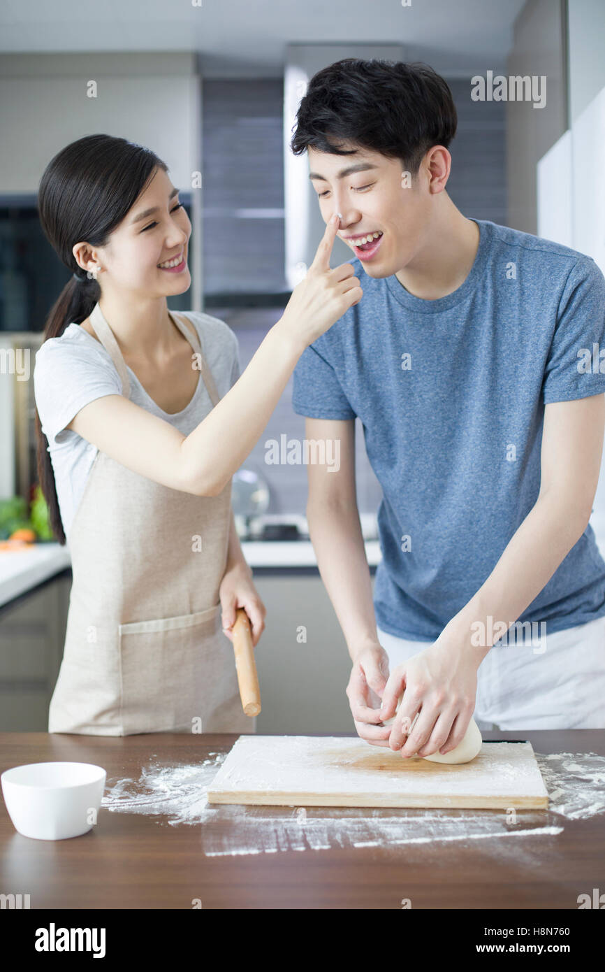Happy young Chinese couple cooking in kitchen Stock Photo: 125856472 ...