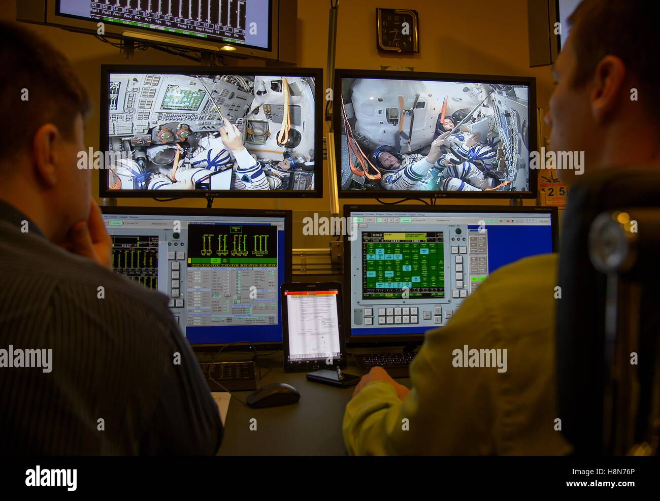 Ground control operators watch NASA International Space Station