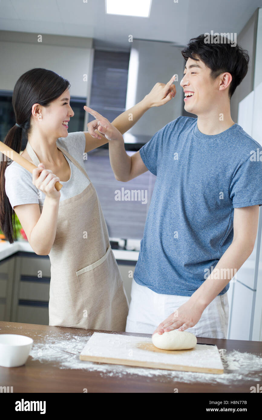 Happy young Chinese couple cooking in kitchen Stock Photo: 125856511 ...