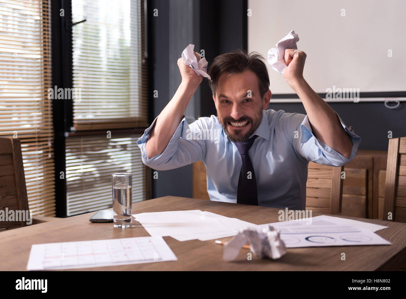 Angry hysterical man having a nervous breakdown - Stock Image