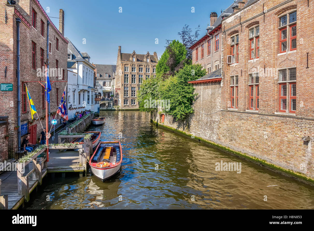 Boats Tied Up On The Canal Bruges Belgium - Stock Image