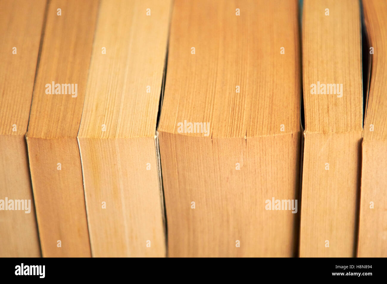 row of used paperback books in the uk - Stock Image