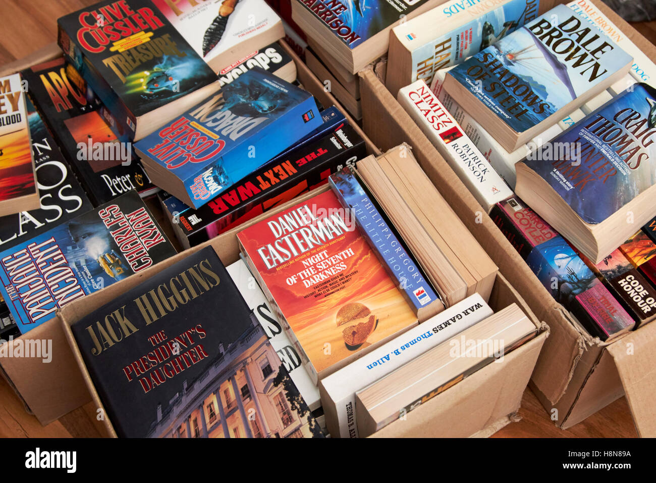 boxes of used paperback books to be donated to charity in the uk - Stock Image