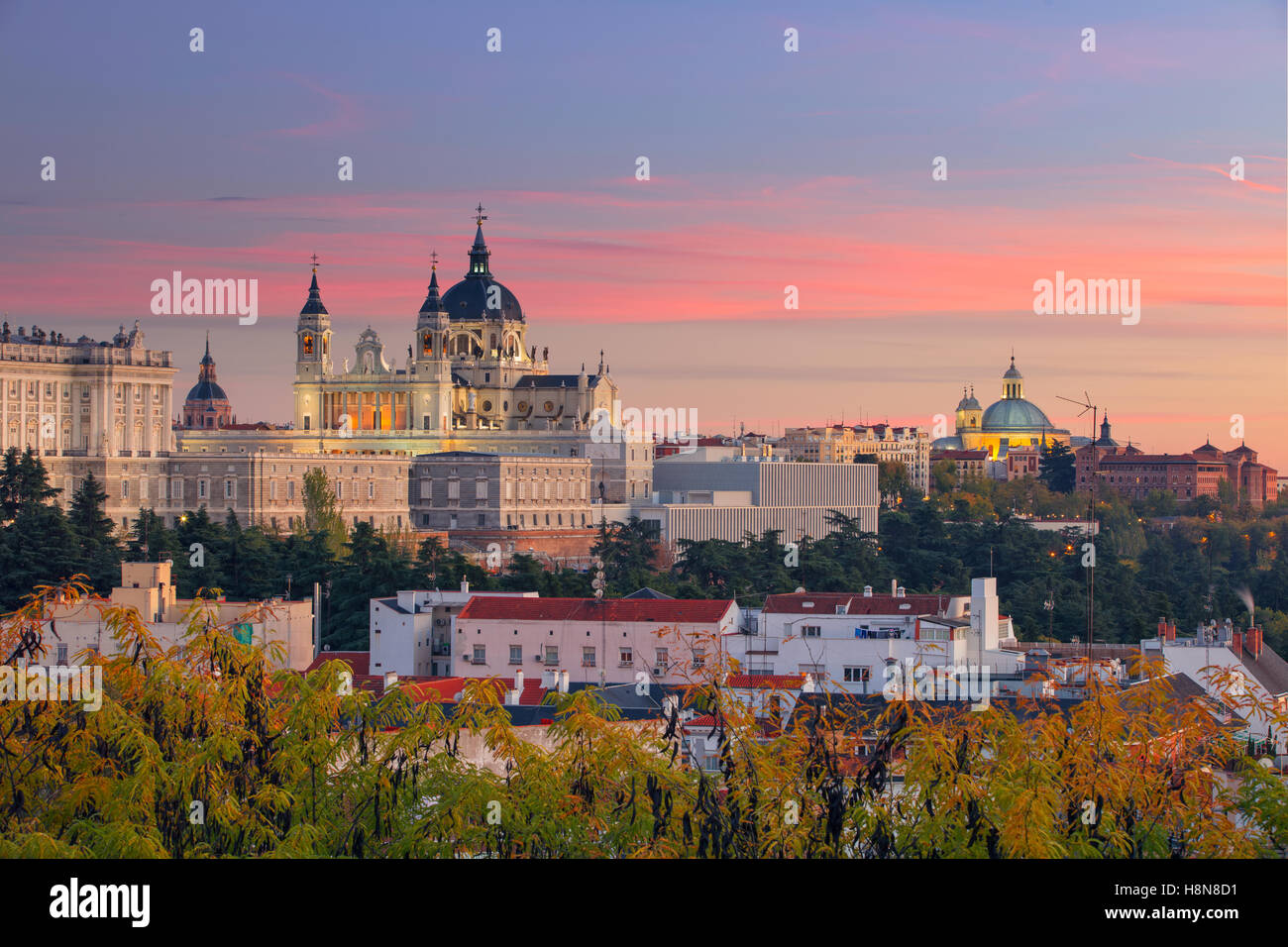 Image of Madrid Skyline with Santa Maria la Real de La Almudena Cathedral and the Royal Palace during sunset. - Stock Image