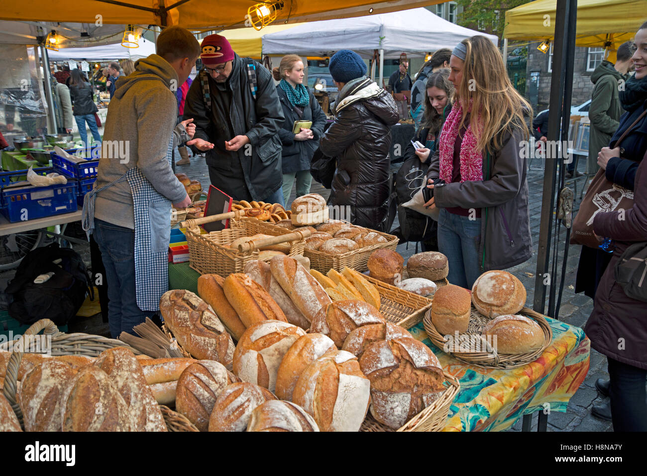 Artisan bread on sale at a stall in the Grassmarket, Edinburgh, Scotland, UK. - Stock Image