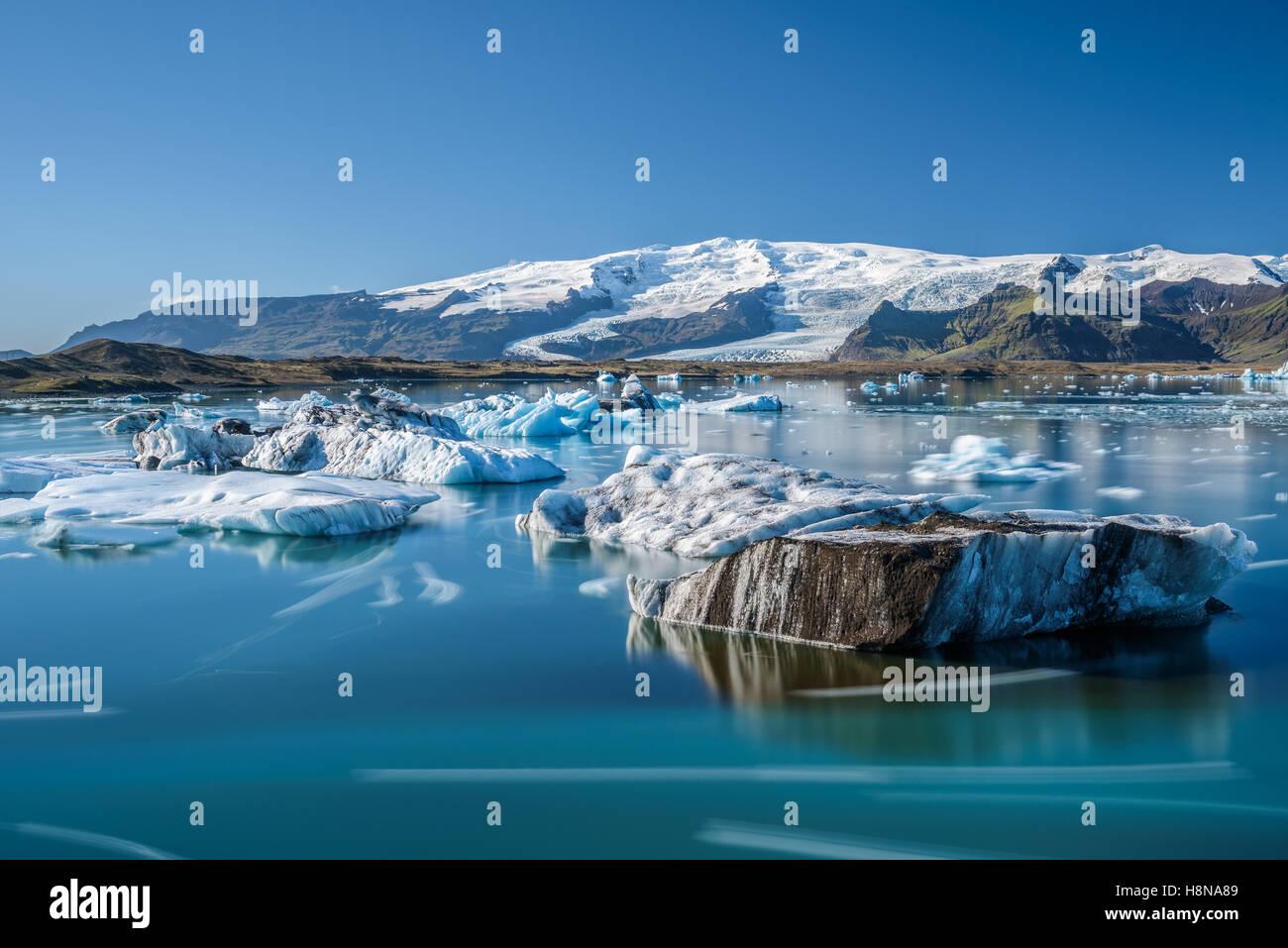 Floating icebergs in Jokulsarlon glacier lagoon, Iceland. - Stock Image
