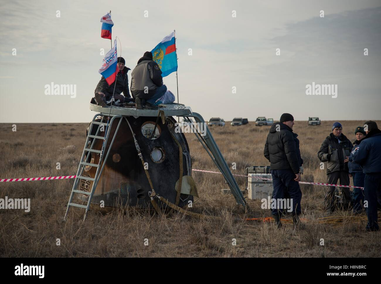 Russian support personnel work around the Soyuz MS-01 spacecraft after landing in a remote area October 30, 2016 - Stock Image