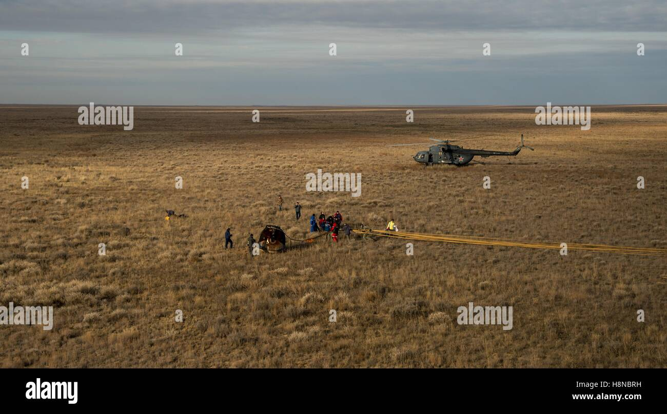 Russian Search and Rescue teams arrive at the Soyuz MS-01 spacecraft after landing in a remote area October 30, - Stock Image