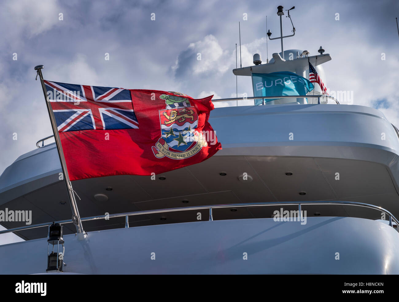 Cayman islands Red Ensign flag on a luxury superyacht Stock Photo