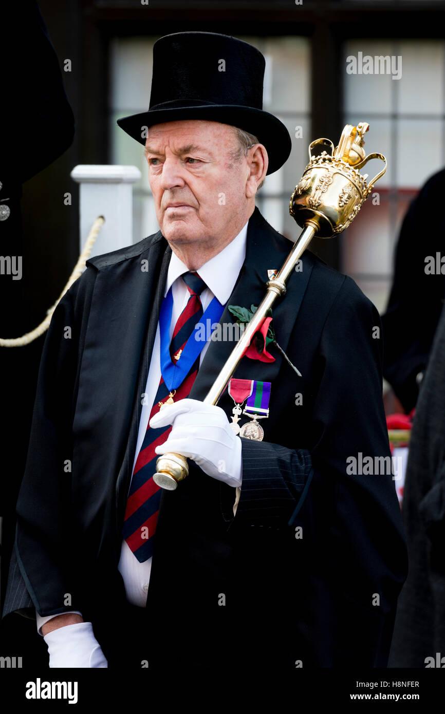 A mace-bearer at the Stratford-upon-Avon Remembrance Sunday parade, Warwickshire, England, UK - Stock Image
