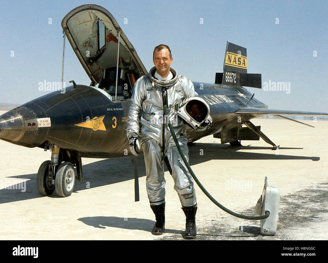 NASA astronaut and research pilot Bill Dana stands next to the North American X-15 hypersonic rocket-powered aircraft - Stock Image