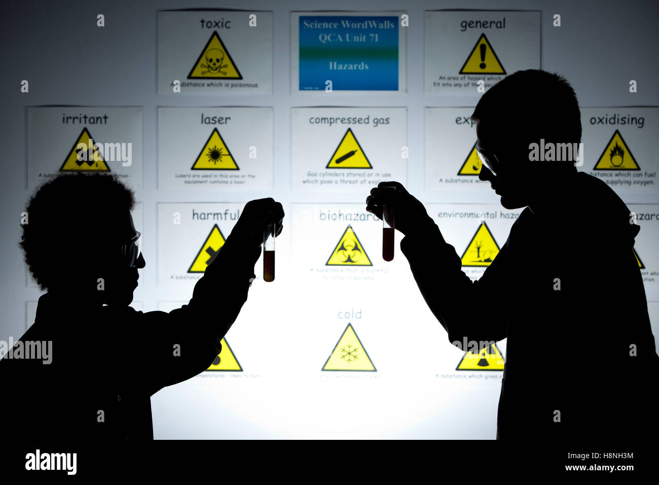 teenage pupils during a Forensic science lesson at school - Stock Image