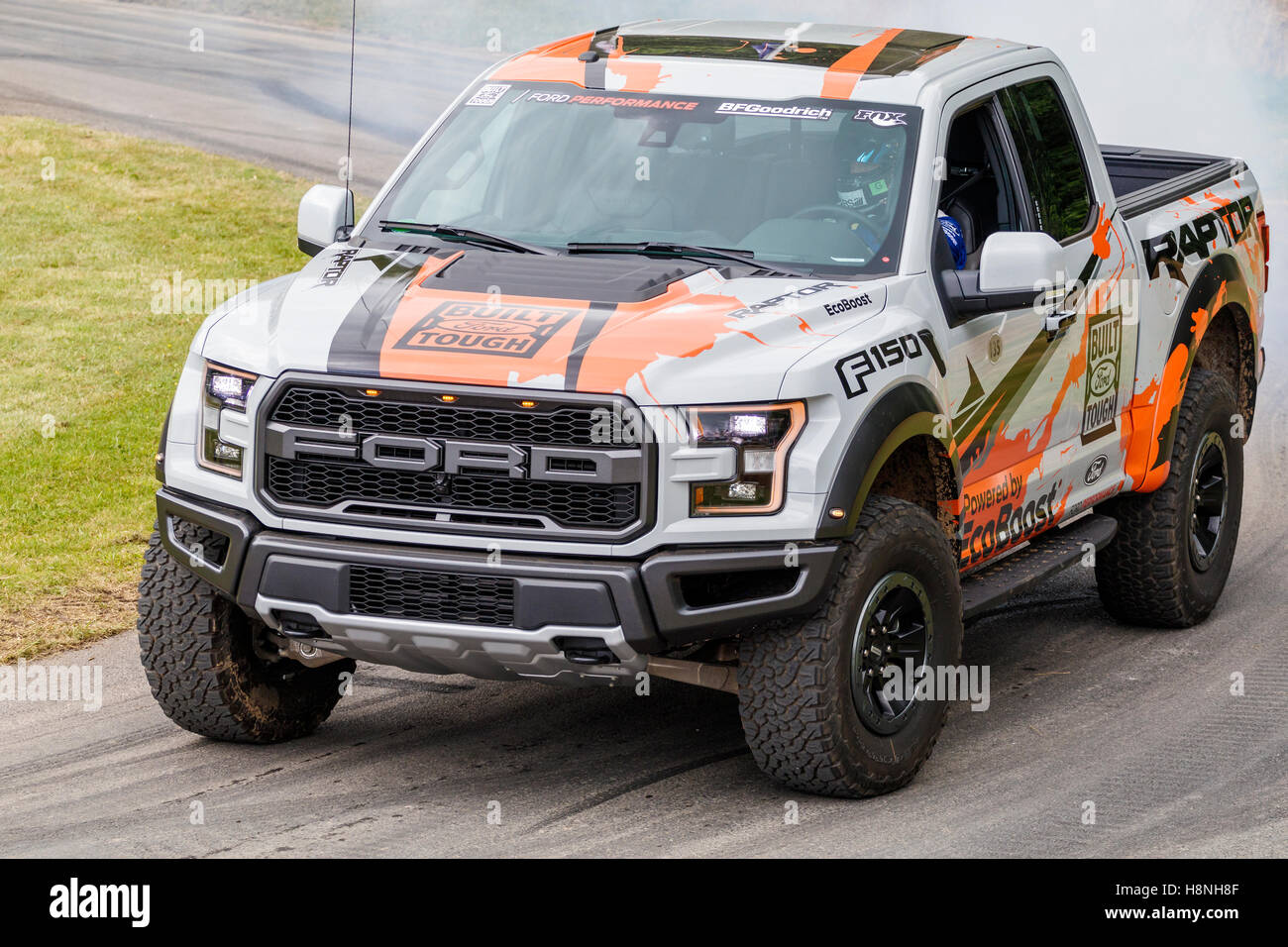 2016 Ford F-150 Raptor desert truck racer with driver Ben Collins at the 2016 Goodwood Festival of Speed, Sussex, - Stock Image