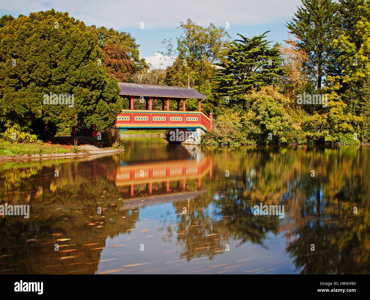 Swiss Bridge and lakeside reflections - Stock Image