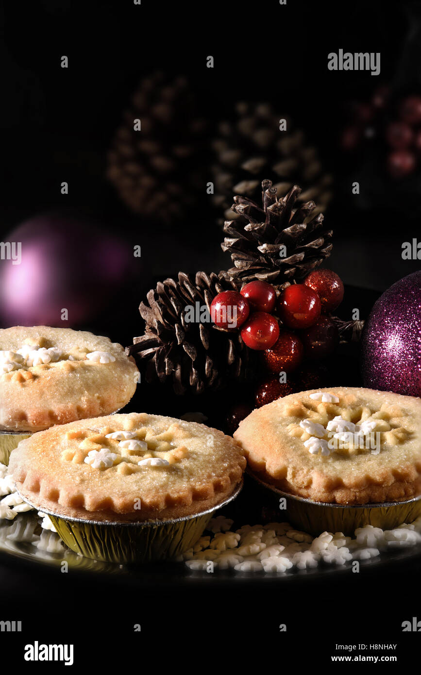 Festive Rhubarb and stem ginger pies in a rustic setting with creative lighting with generous accommodation for - Stock Image