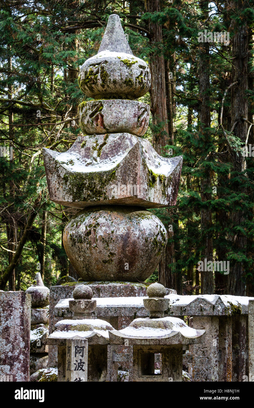 Japan, Koyasan, Okunoin cemetery. Gorinto, five stone tower AKA five stone pagoda with cedar forest background. - Stock Image