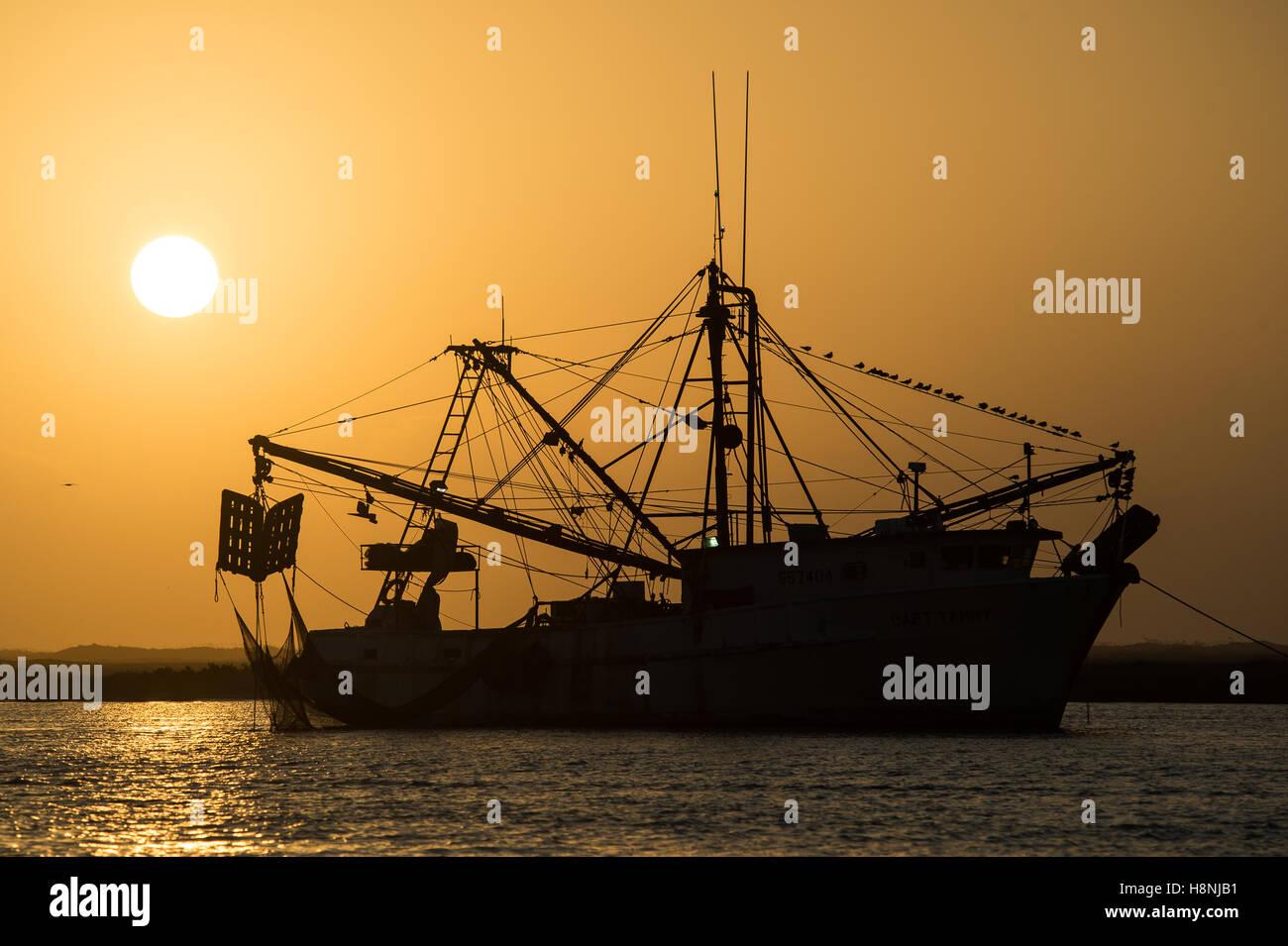 Shrimp boat at sunrise near Port Aransas Texas - Stock Image
