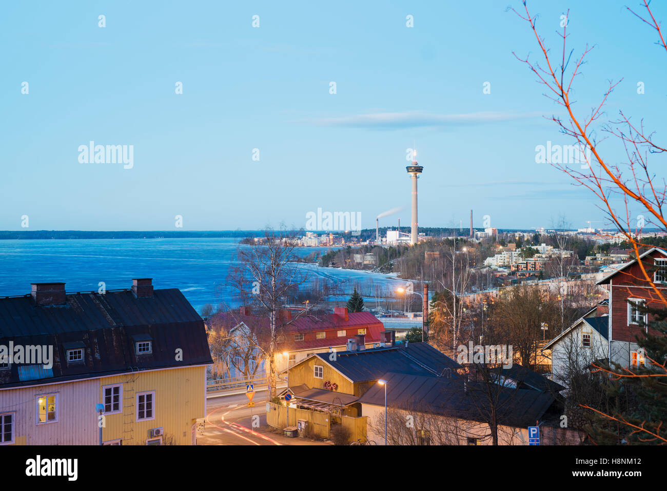 View on lake from above rooftops - Stock Image