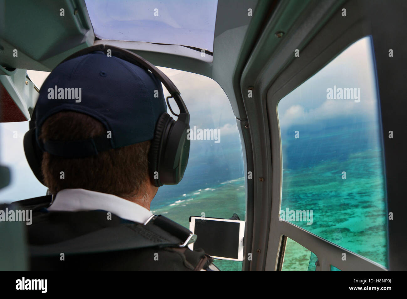 Person fly in helicopter above the Great Barrier Reef Queensland Australia. - Stock Image