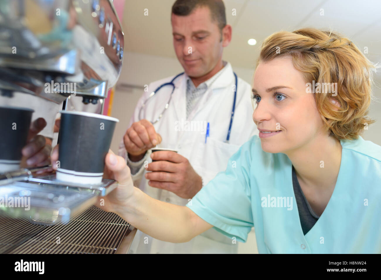 young team of doctors having coffee break at hospital Stock Photo