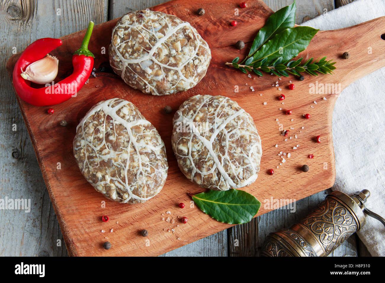 Caul-Fat Meatballs raw burger cutlet handmade on desk - Stock Image