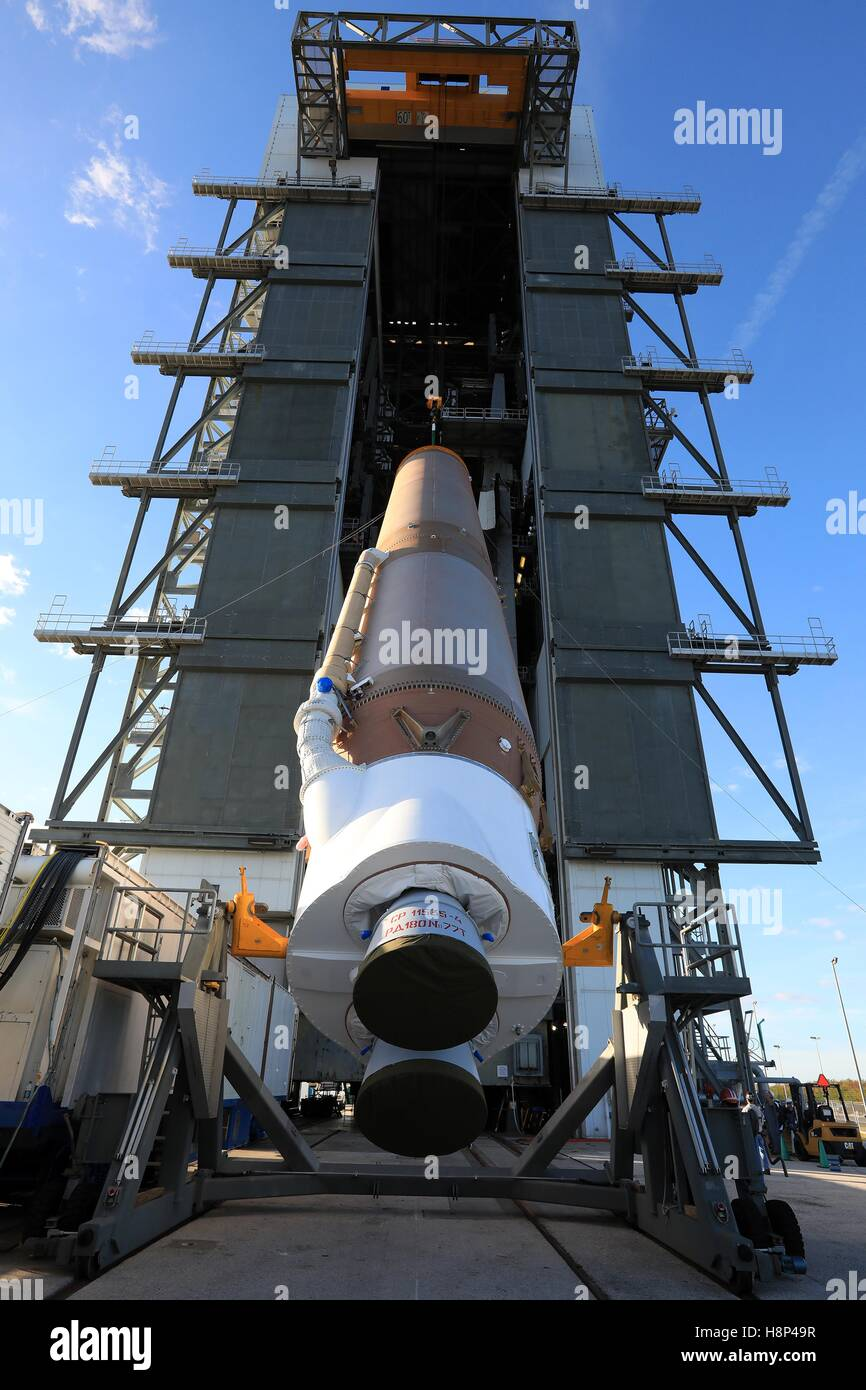 The United Launch Alliance Atlas V rocket first stage is lifted into the vertical position in preparation for the - Stock Image