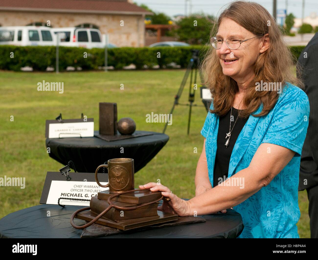 Chief Officer Michael Cahill widow Joleen Cahill touches a memorial sculpture that honors her husband at the groundbreaking - Stock Image