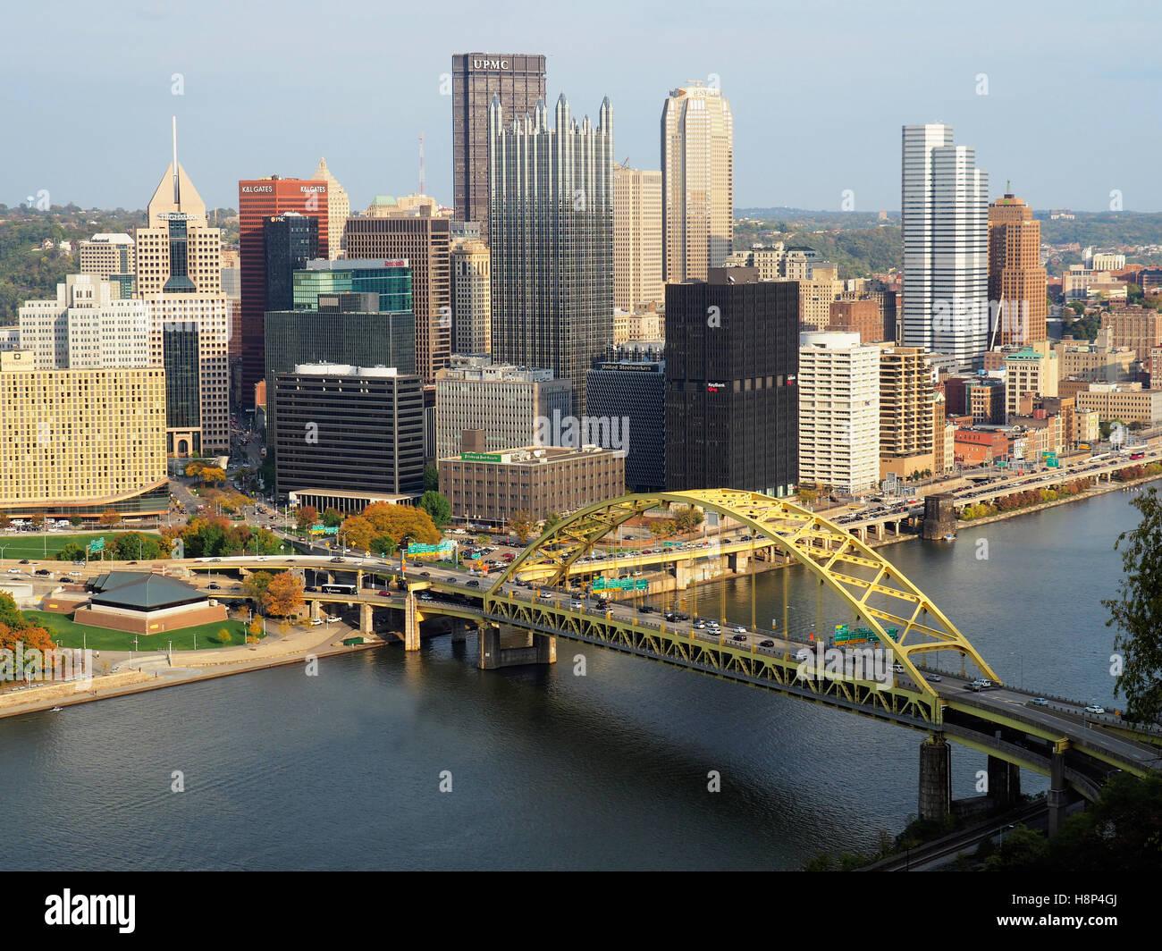 Pittsburgh downtown skyline with highway bridge over Monongahela River. - Stock Image