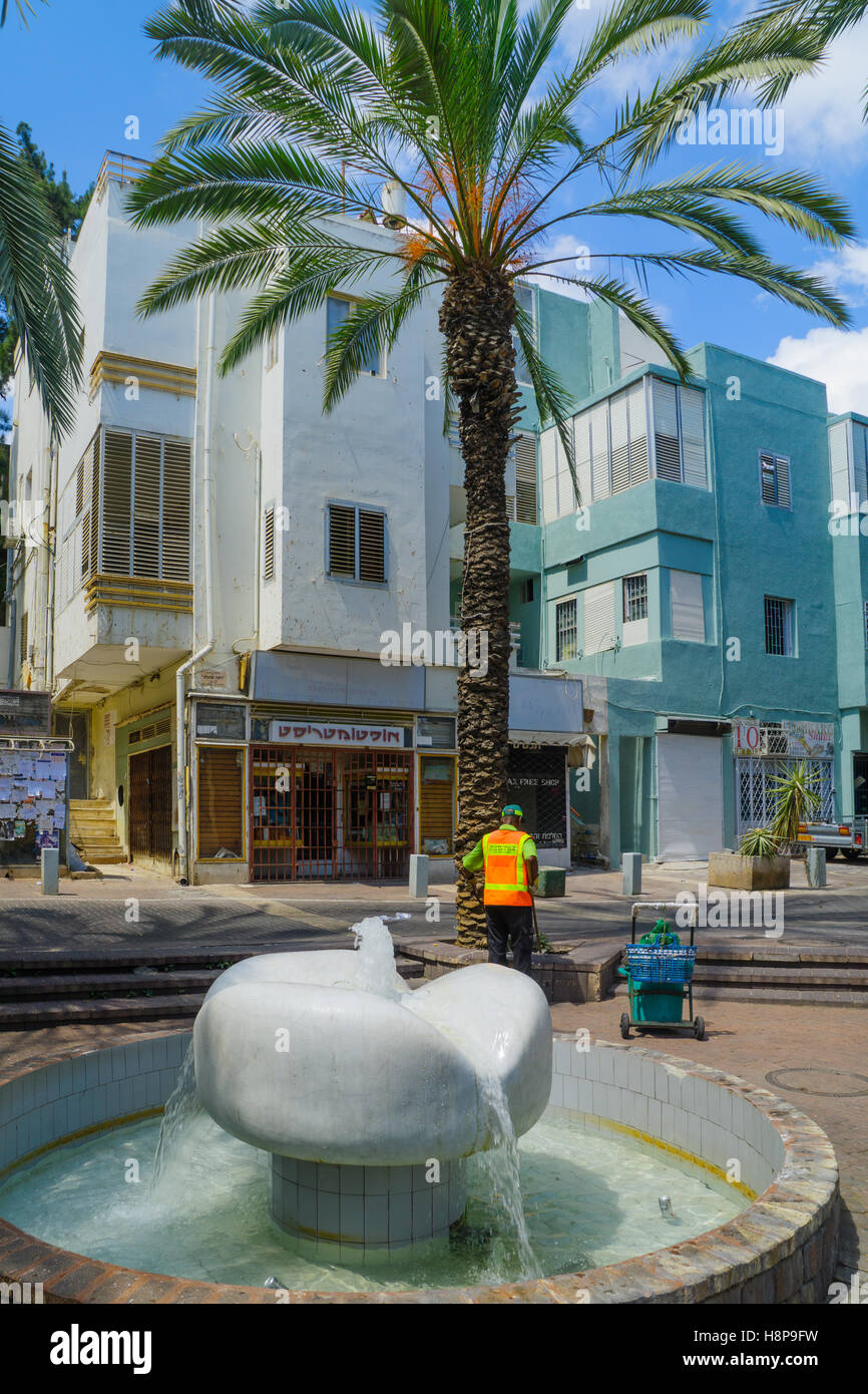 HAIFA, ISRAEL - AUGUST 18, 2016: Scene of the Pedestrianized Nordau Street, with a fountain, locals and visitors, - Stock Image
