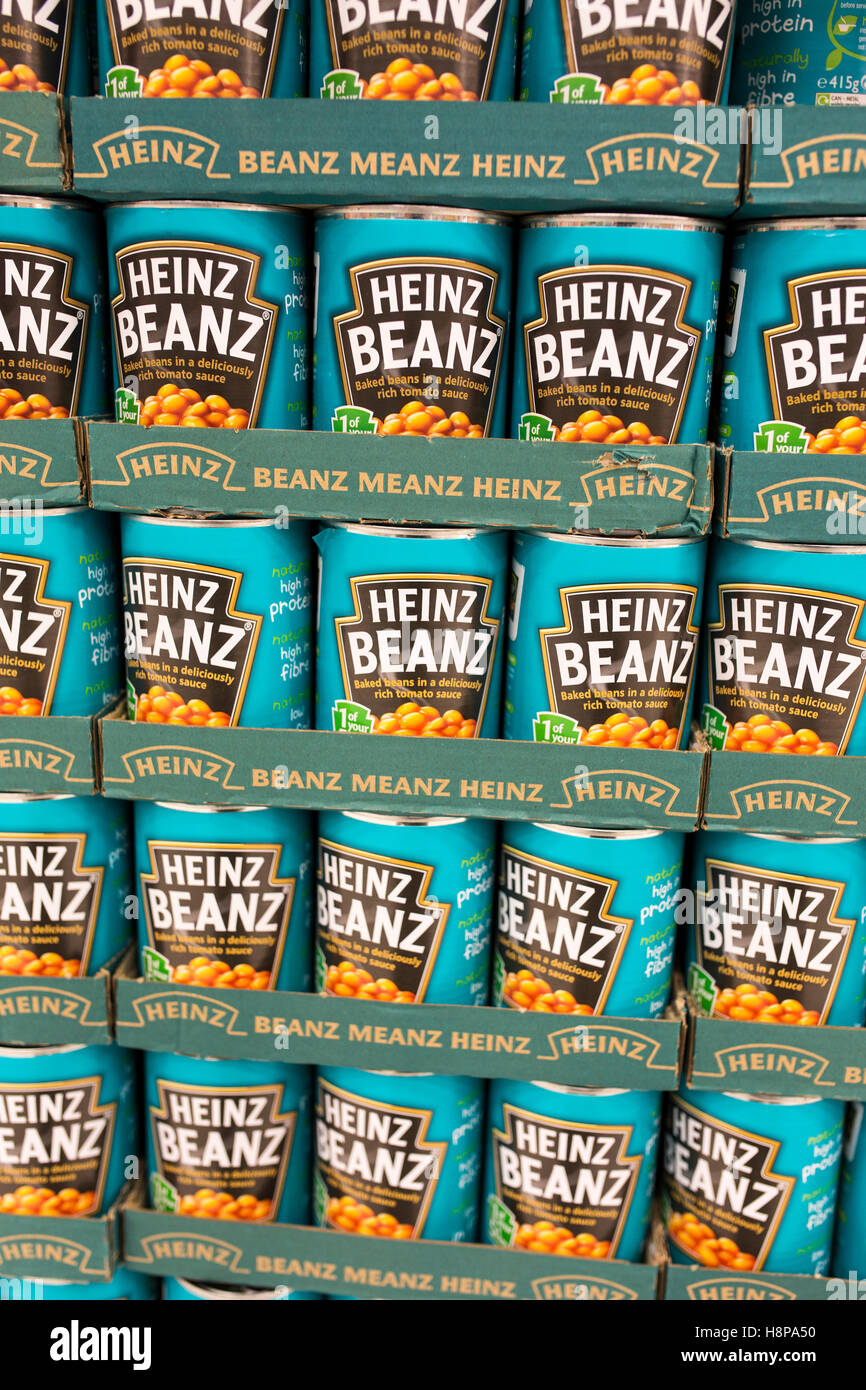 tins of Heinz baked beans on supermarket shelves - Stock Image
