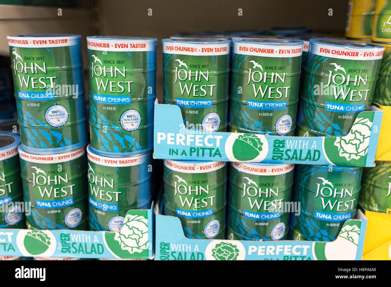 tins of John West tuna on supermarket shelves - Stock Image