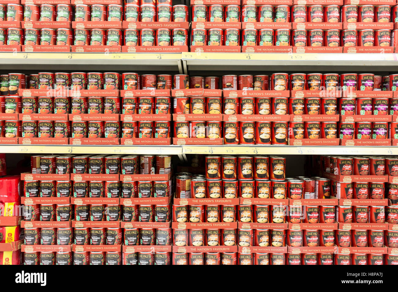 tins of Heinz soup on supermarket shelves Stock Photo