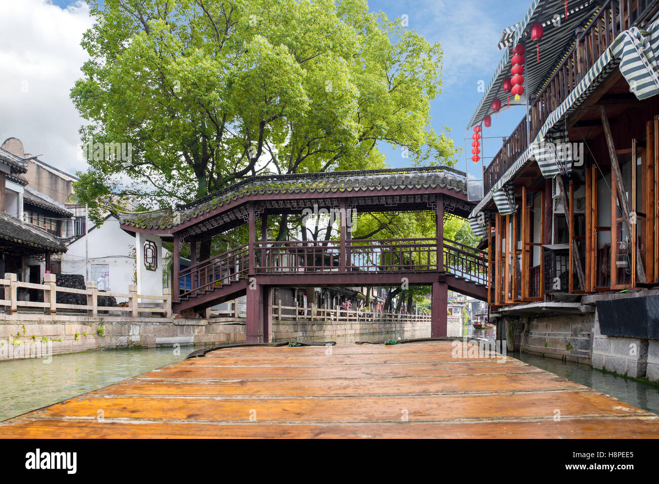 Point of view of China traditional tourist boats along canals of Shanghai Zhujiajiao Water Town in Shanghai, China. - Stock Image