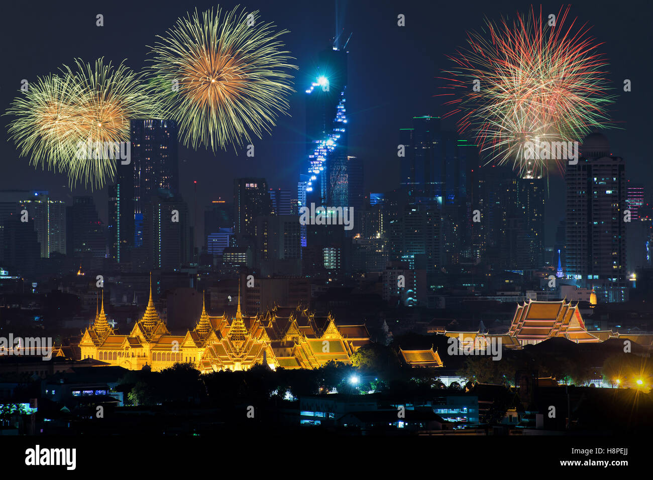 Beautiful fireworks celebrating new year with grand palace and Bangkok city in background at Bangkok, Thailand - Stock Image