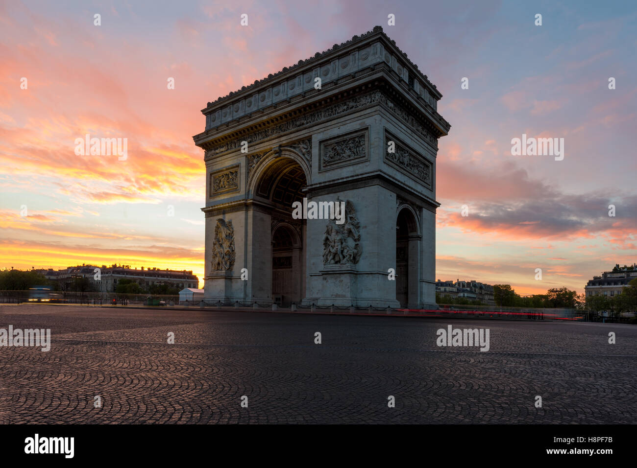Arc de Triomphe and Champs Elysees, Landmarks in center of Paris, at sunset. Paris, France - Stock Image