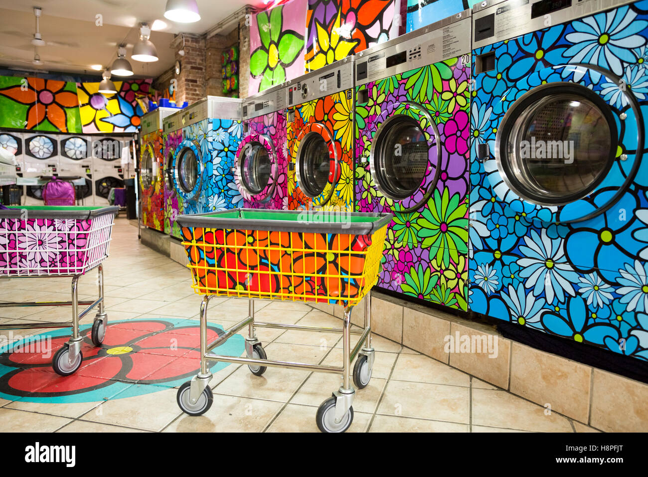 Unique retro painted washer / dryers in a local laundromat, New York City, NY, USA - Stock Image