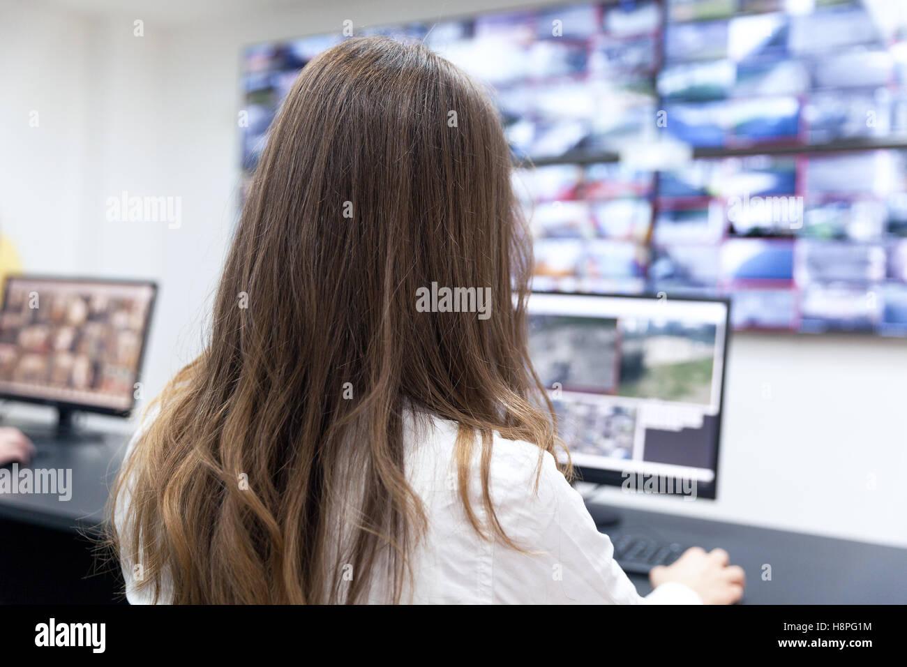 Control room operator. Security video surveillance. - Stock Image