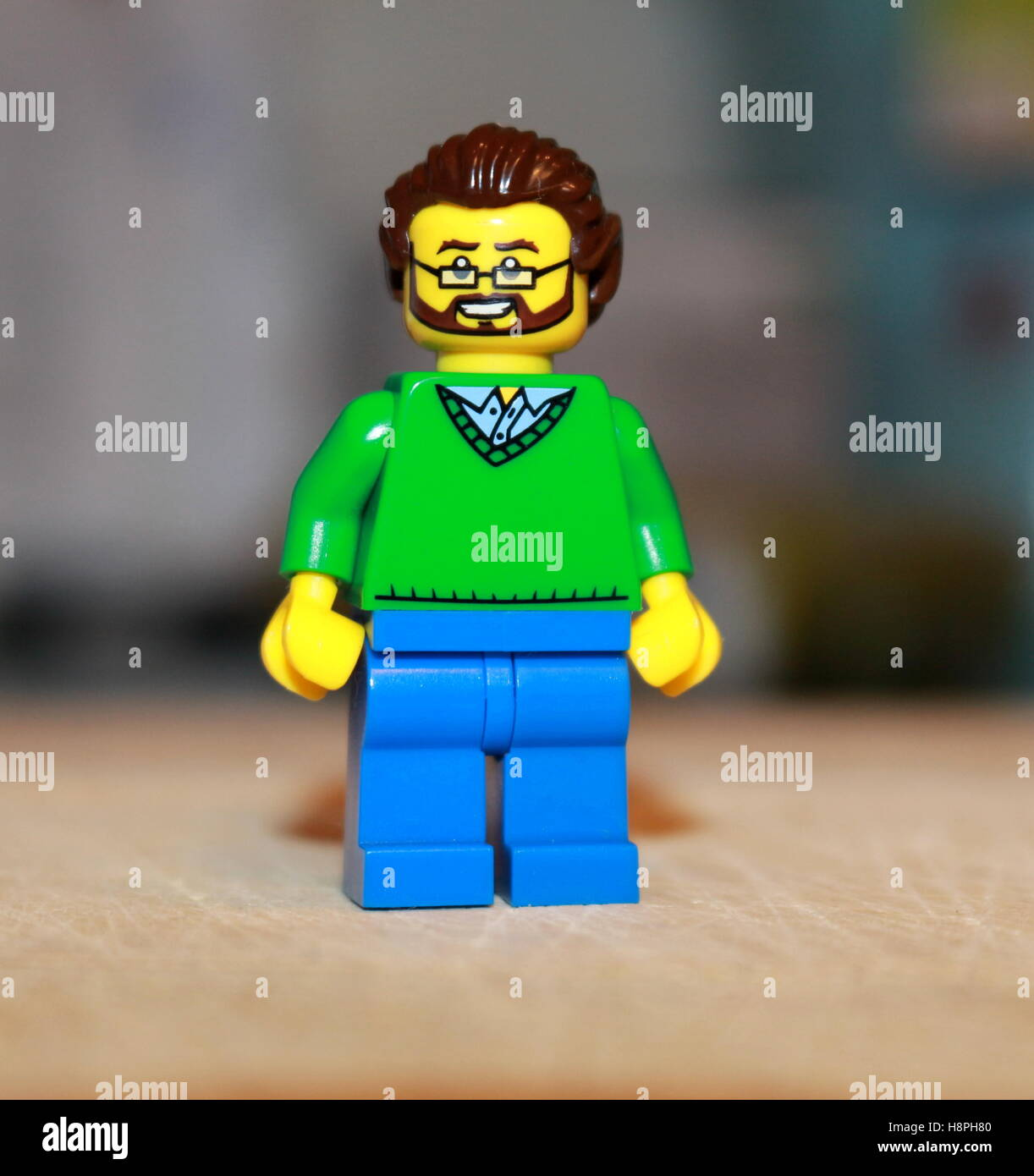 A Lego man with glasses and a beard - Stock Image